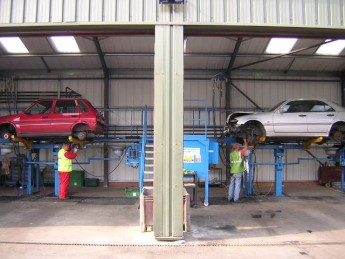 ASM staff on de-pollution rigs in the workshop
