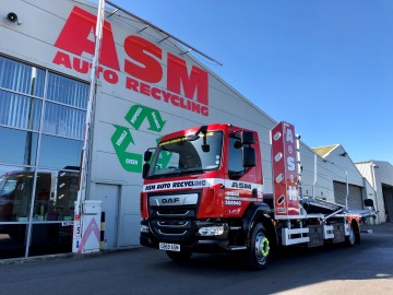 Car transporter at ASM Auto Recycling in Thame, Oxford