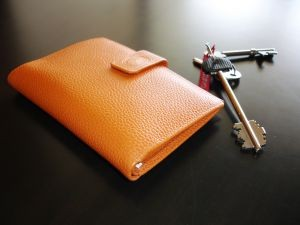 Wallet and keys on tabletop