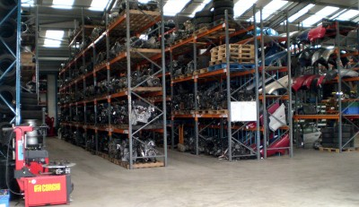 Warehouse with organised racks of used car parts