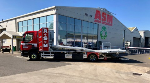 Car transporter outside ASM Auto Recycling HQ in Thame, Oxford