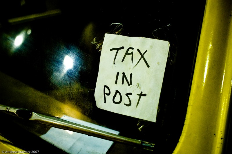 Note in car window says 'TAX IN POST'