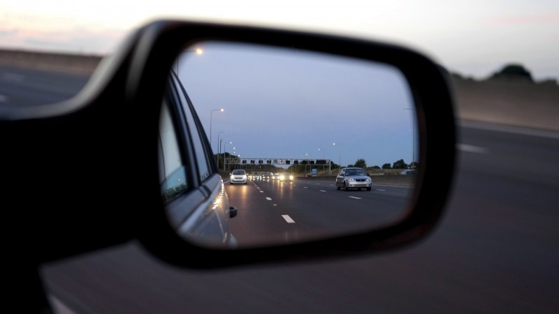 Wing mirror viewing motorway traffic
