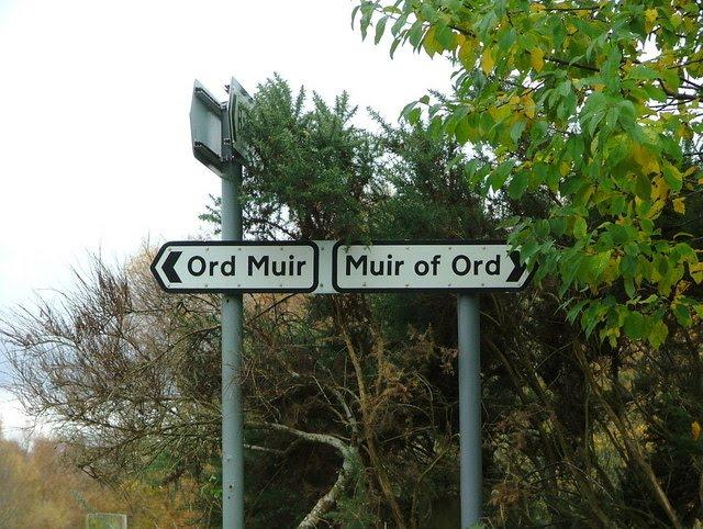 Sign left says 'Ord Muir', sign right says 'Muir of Ord'