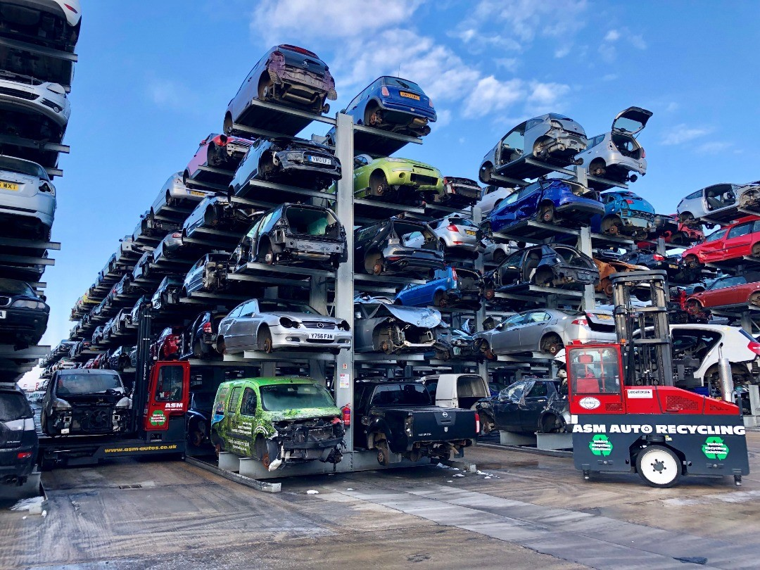 Fully stocked car racks with forklifts in ASM's compound