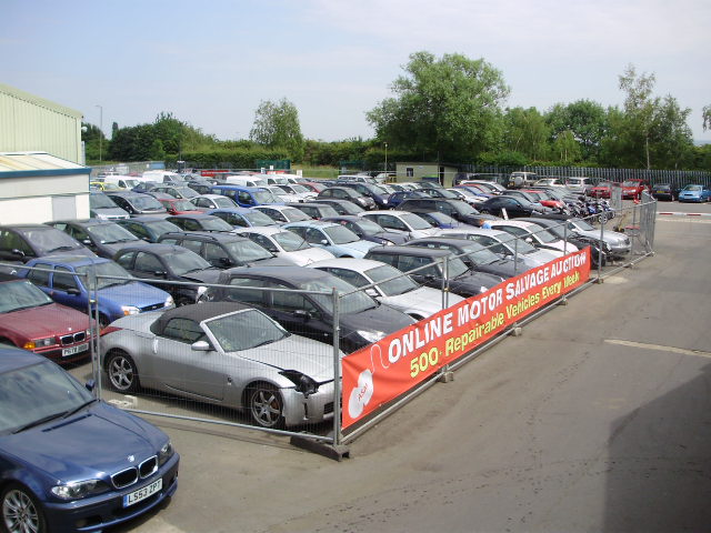 Auction cars for inspection on a lot at ASM Auto Recycling in Thame, Oxford.